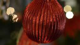 Closeup of a Red Bauble on a Christmas Tree Footage