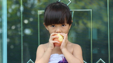 Girl And Her Apple stock footage