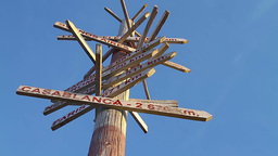 Wooden traffic sign pointing to various places Footage
