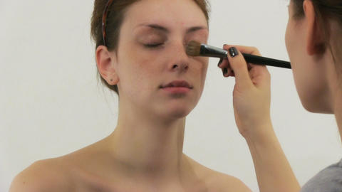 Woman having make up in beauty salon Footage