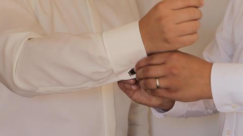 Hands of wedding groom getting ready in suit Footage