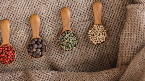 4 Pepper Blend spices small spoon on top sackcloth Live Action