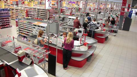 Crane shot of cash desk at a supermarket. Going up Footage