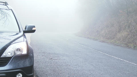 Car Needs Help on Scary Foggy Winter Forest Road 1 Footage