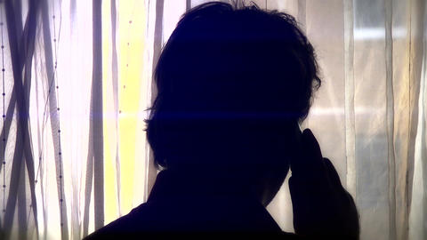 Man Behind Curtain Talking Phone Silhouette 3 Footage