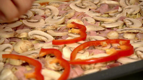 Putting Sliced Red Peppers On Pizza stock footage