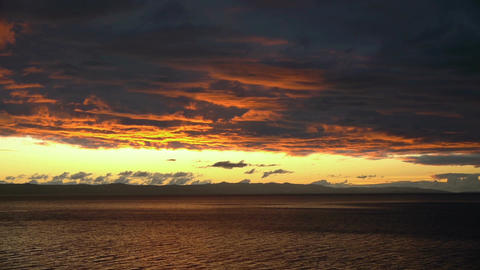 Sunset on sea with clouds timelapse Footage