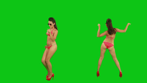 Beautiful girl in pareo dancing against green scre Footage