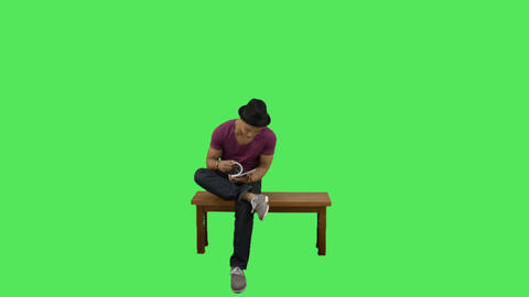 Male sitting on bench reading Footage