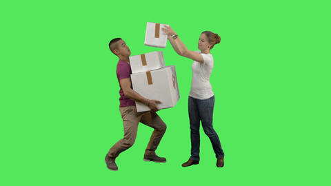 Couple carrying a boxes Live Action