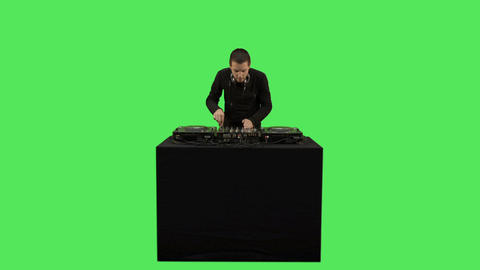 Male DJ playing music on decks Footage