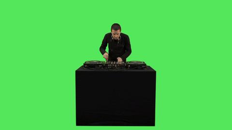 Male DJ playing music on decks Footage