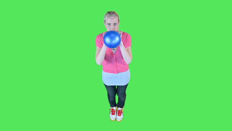 Female blowing up balloon Footage