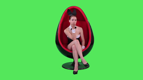 Female bunny in chair flirting Footage