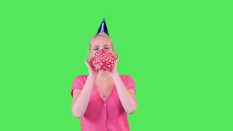 Female blowing up balloon Live Action