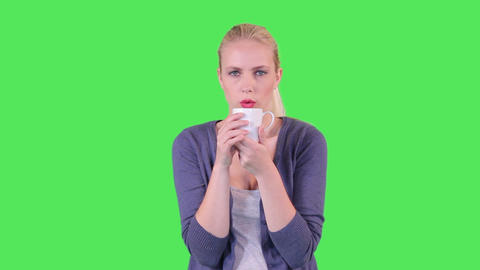 Female drinking a cup of tea Footage