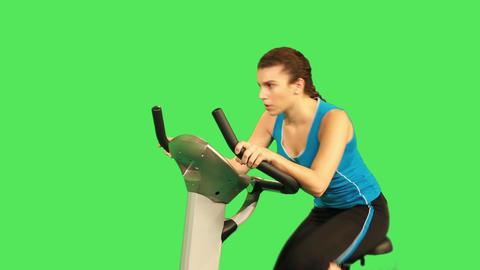 female training on exercise bicycle Footage