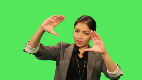 Asian female making hand gestures Live Action