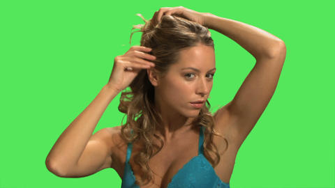 A young woman adjusting her hair Footage