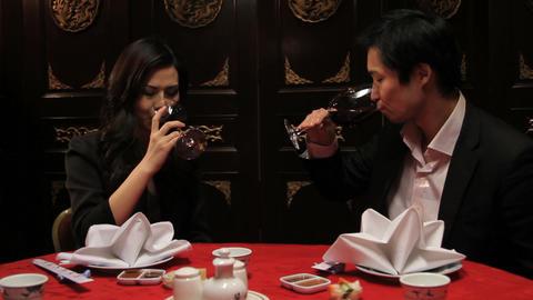 Couple toasting in Chinese restaurant Footage