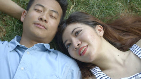 Young couple relaxing on grass Footage