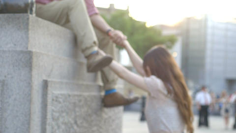 Man helping woman to climb on pedestal Footage