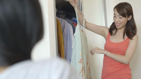 Young woman trying clothes near cupboard Footage