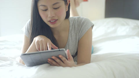 Young woman using tablet in bedroom Footage