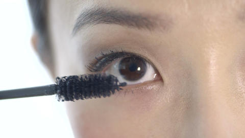 Woman applying mascara Footage