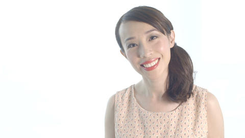 Young woman smiling against white background Footage