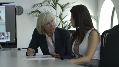 Businesswoman discussing in office Footage