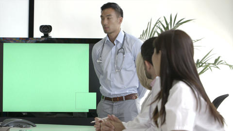 Male doctor explaining with projection equipment in meeting room Footage