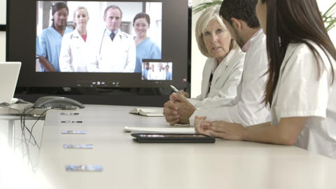 Doctors explaining with projection equipment in meeting room Footage