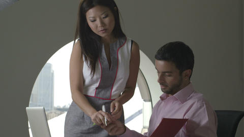 Businessman and businesswoman working in office Footage