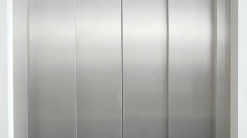 Man staring at woman on elevator Footage