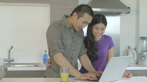 Young Couple Standing In Kitchen stock footage