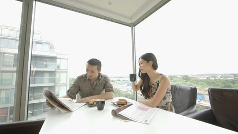 Young couple having coffee with reading newspaper in office Footage