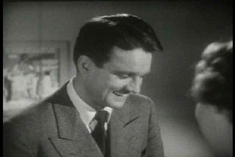 Archival film depicting a man sending a telegram v Footage