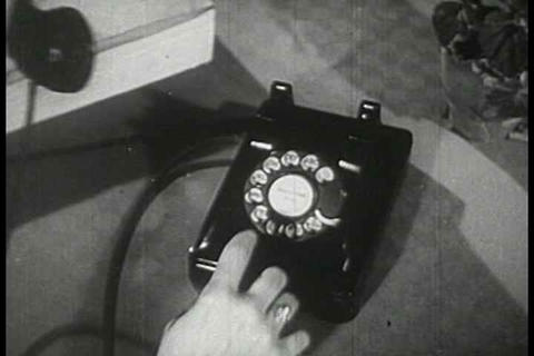 Telephone operators answer calls and direct a swit Footage