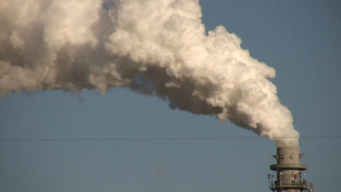 Large chimney is exhausting a long trail of fumes Stock Video Footage