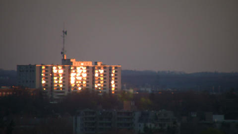 Sunrise reflects off the building's window (High Definition) Footage