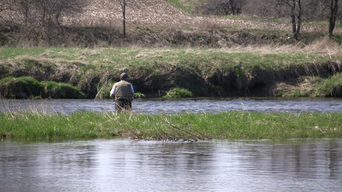 Man is fly fishing on a sunny day (High Definition) Footage
