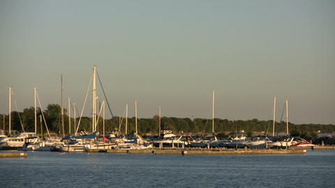 Small boat marina rests in the distance (High Definition) Stock Video Footage