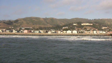 Ocean waves wash up on the sunny San Francisco beach Stock Video Footage