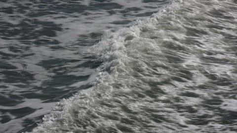 Close-up of ocean wave traveling towards the shore (High... Stock Video Footage