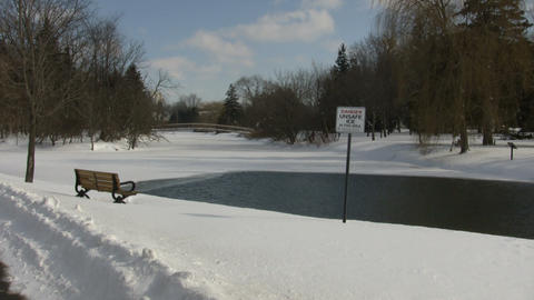 Winter scenic with thin ice sign near pond (High Definition) Footage