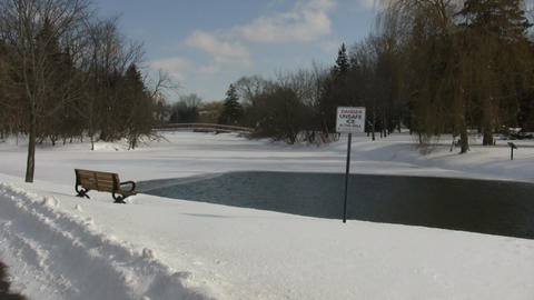Winter scenic with thin ice sign near pond (High Definition) Stock Video Footage