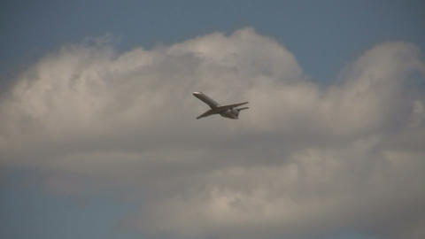 Commercial jet ascends through the blue sky Stock Video Footage