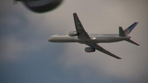 Closeup of a commercial jet ascending through the blue sky Stock Video Footage