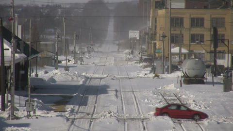 Winter scenic of cars driving over train tracks (High... Stock Video Footage
